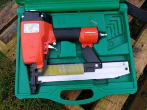 Air powered staple gun